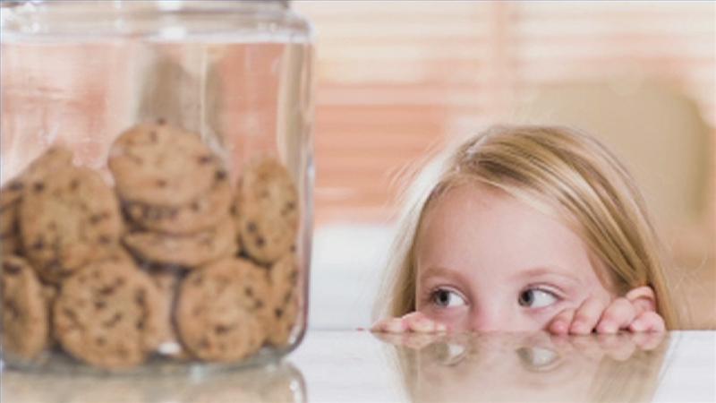 lying child eyeing cookie jar