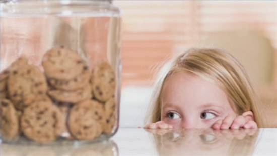 lying child eyeing cookie jar