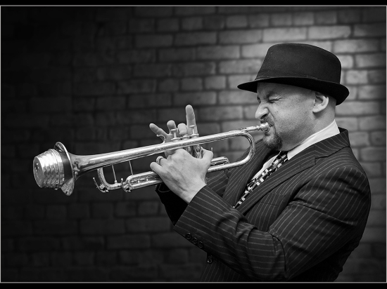 musician morris alan playing trumpet