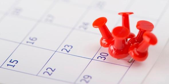 5 tacks on a single date on a calendar