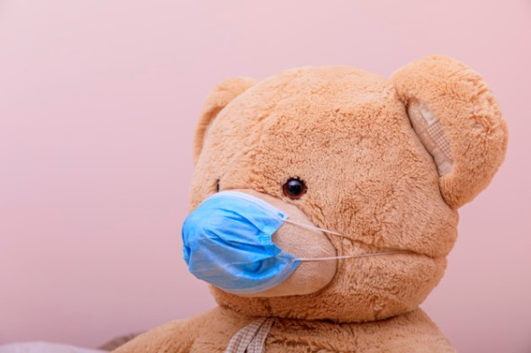 Teddy Bear wearing a face mask to protect against COVID-19 spread