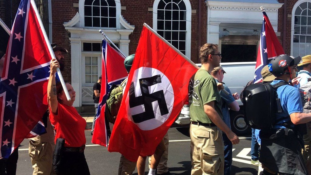 Fuck Neo-Nazis. People carrying confederate and Nazi flags (so the same fucking flag basically).