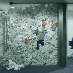 Man pressed against glass in office. The entire office is full of papers pressing against him. He's drowning in work.