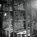 Black and white photo of the Cincinnati Old Main Library taken 1874. There is a single person for scale and the library is massive in size with several levels seen in the single photo alone. Unfortunately the library was torn down in 1955.
